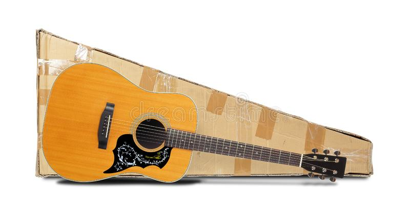 Postage and packing service, Music and sound - Acoustic guitar and package. Isolated. Postage and packing service, Music and sound - Purchase Acoustic guitar and stock image