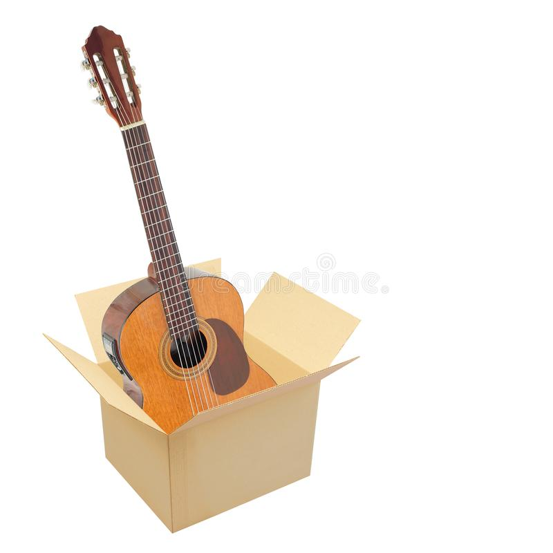 Postage and packing service, Music and sound - Classic guitar in package. Isolated. Postage and packing service, Music and sound - Classic guitar in package on a royalty free stock photos