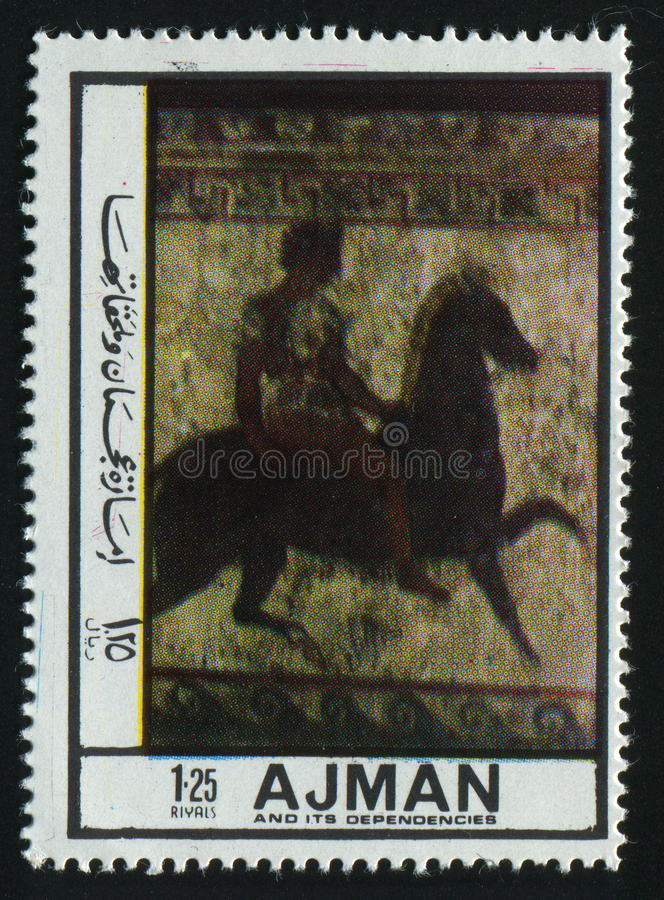 Postage stamp. AJMAN - CIRCA 1972: Ancient picture, the person on a horse, circa 1972 stock images