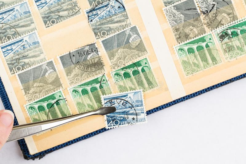 Postage Stamp held by Stamp Collector royalty free stock image