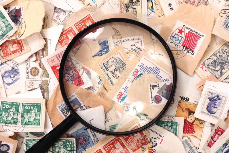 Postage stamp and magnify glass. As nice background stock photo
