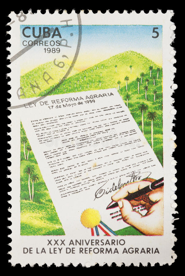 Postage stamp printed in Cuba shows the anniversary of the signature of the law of agrarian reform stock photo