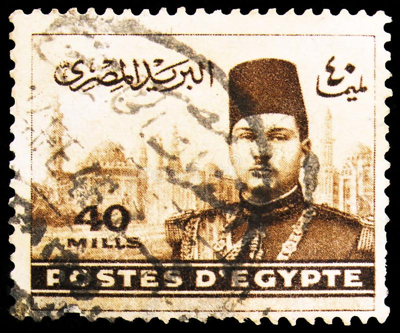 Postage stamp printed in Egypt shows King Farouk in front of El Rifai Mosque, 40 Egyptian millieme, serie, circa 1939. MOSCOW, RUSSIA - OCTOBER 1, 2019: Postage royalty free stock images