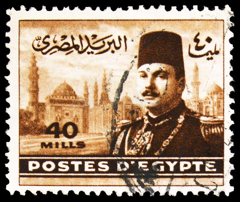 Postage stamp printed in Egypt shows King Farouk in front of Hussan Mosque, 40 Egyptian millieme, serie, circa 1947. MOSCOW, RUSSIA - OCTOBER 1, 2019: Postage stock image