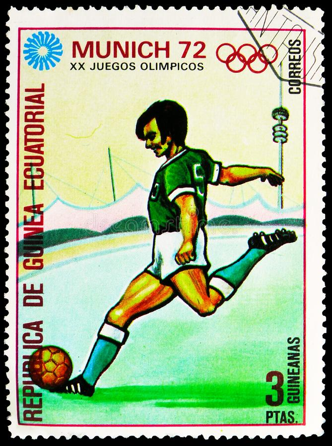 Postage stamp printed in Equatorial Guinea shows Football, Summer Olympics 1972, Munich: Sports disciplines serie, circa 1972. MOSCOW, RUSSIA - SEPTEMBER 30 stock photos