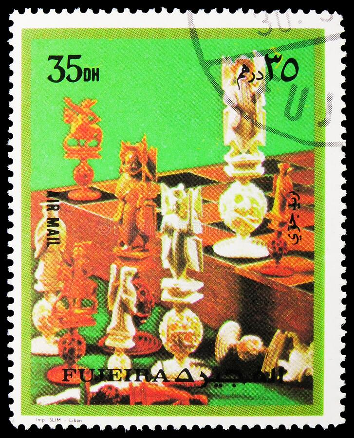 Postage stamp printed in Fujairah (United Arab Emirates) shows Various Games of Chess, Games of Chess serie, circa 1973. MOSCOW, RUSSIA - NOVEMBER 16, 2019 stock photos