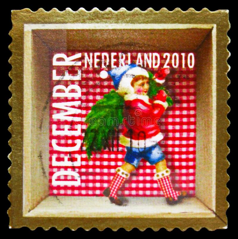 Postage stamp printed in Netherlands shows Christmas dwarf, December Stamps serie, circa 2010 stock photo