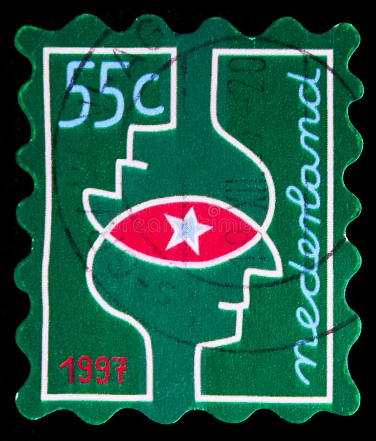 Postage stamp printed in Netherlands shows Christmas thinkings, Green, December Stamps serie, circa 1997 stock image