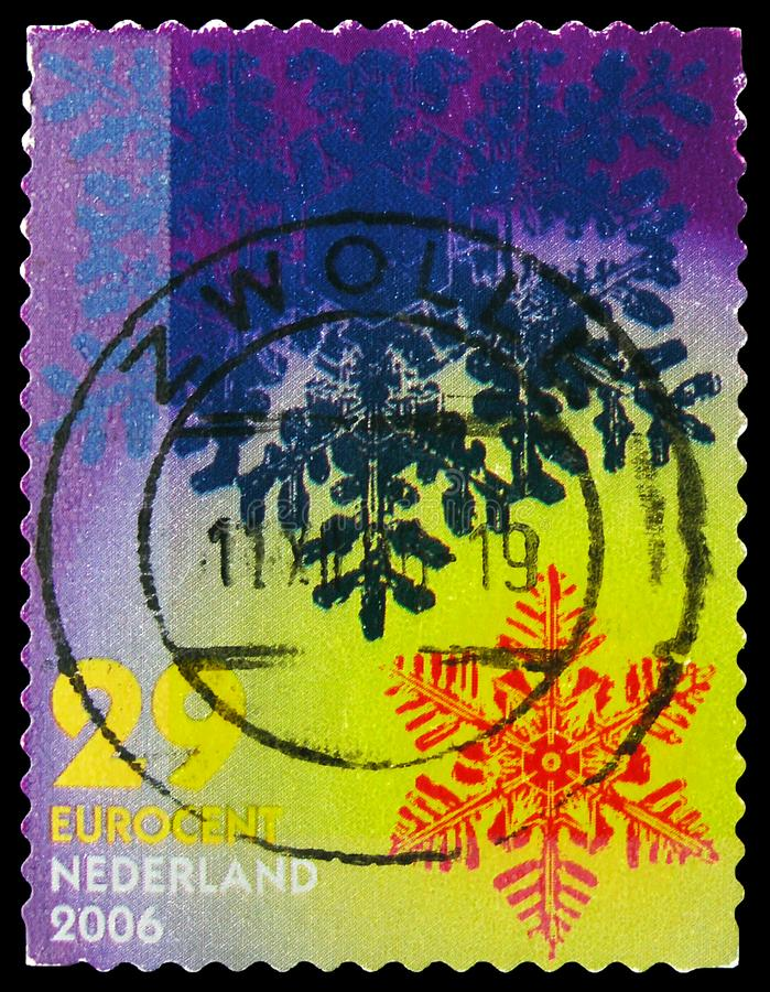 Postage stamp printed in Netherlands shows Snow Crystals, December Stamps serie, circa 2006 royalty free stock image