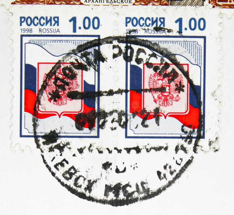 Postage stamp printed in Russia with stamp of Izhevsk city, Udmurtia, shows Coat of arms of Russian Federation, serie, circa 1998. MOSCOW, RUSSIA - MAY 17, 2020 stock photos