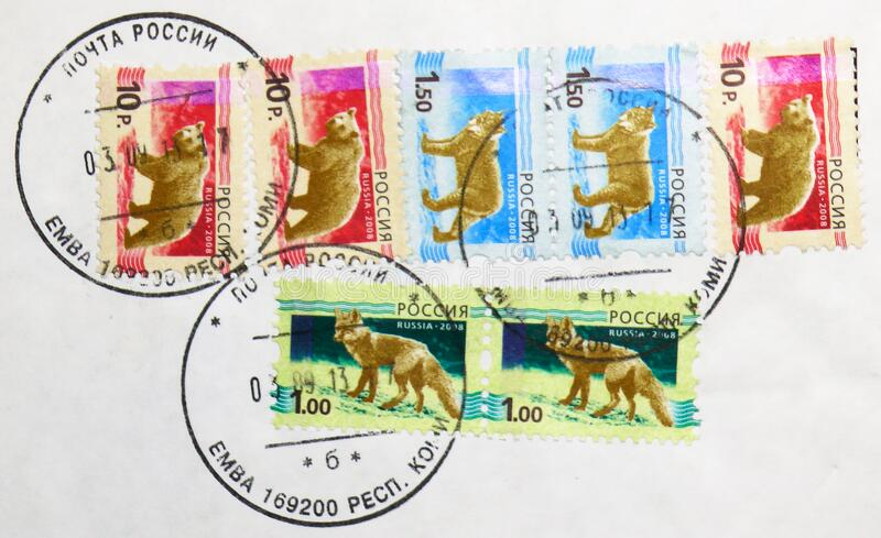 Postage stamp printed in Russia with stamp of Yemva town Komi Republic shows  Brown Bear  Ursus arctos, Red Fox Vulpes vulpes royalty free stock photos