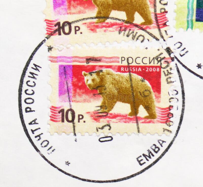 Postage stamp printed in Russia with stamp of Yemva town Komi Republic shows  Brown Bear  Ursus arctos, 5th Definitive Issue royalty free stock images