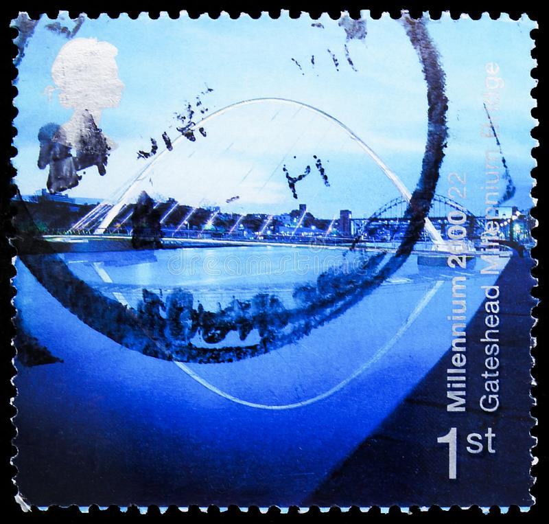 Postage stamp printed in United Kingdom shows Millennium Bridge, Gateshead, Millennium Projects 6 -. MOSCOW, RUSSIA - OCTOBER 4, 2019: Postage stamp printed in royalty free stock photo