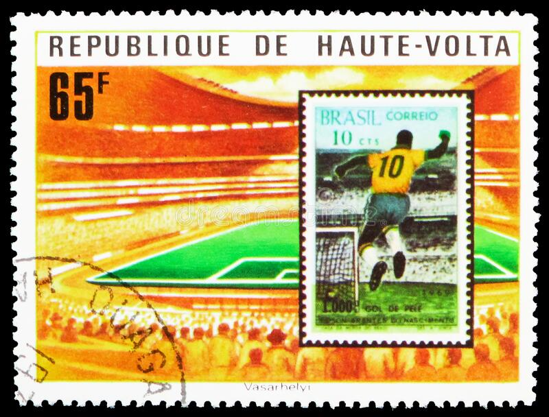 Postage stamp printed in Upper Volta (Burkina Faso) shows Stadium and brasilian stamp, World Cup Football serie, circa 1977. MOSCOW, RUSSIA - MARCH 29, 2020 stock photos