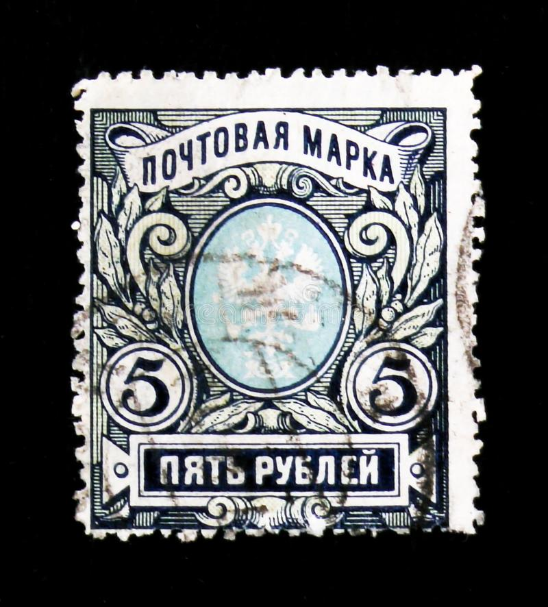 Postage stamp of the Russian Empire with the coat of arms, circa 1911 royalty free stock photos