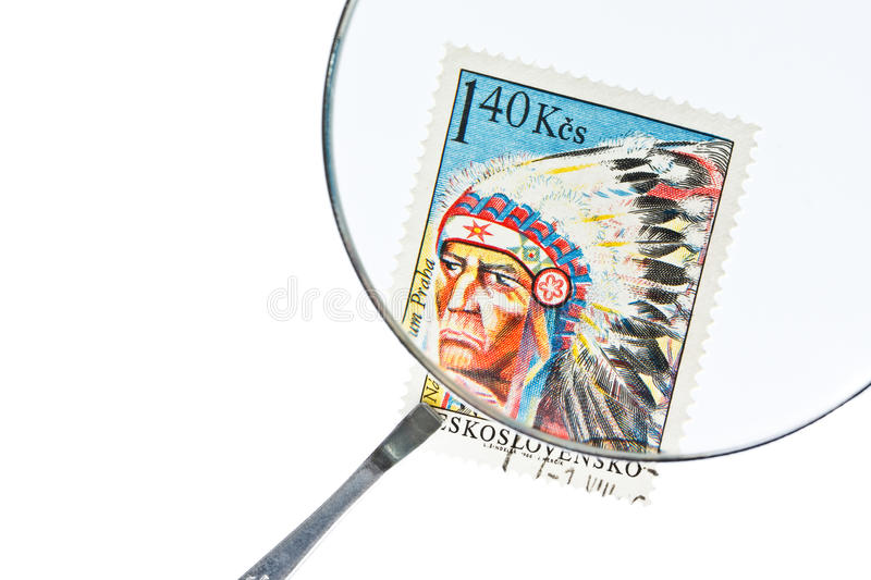 Postage Stamp Under Magnifier With Tweezers Royalty Free Stock Photography