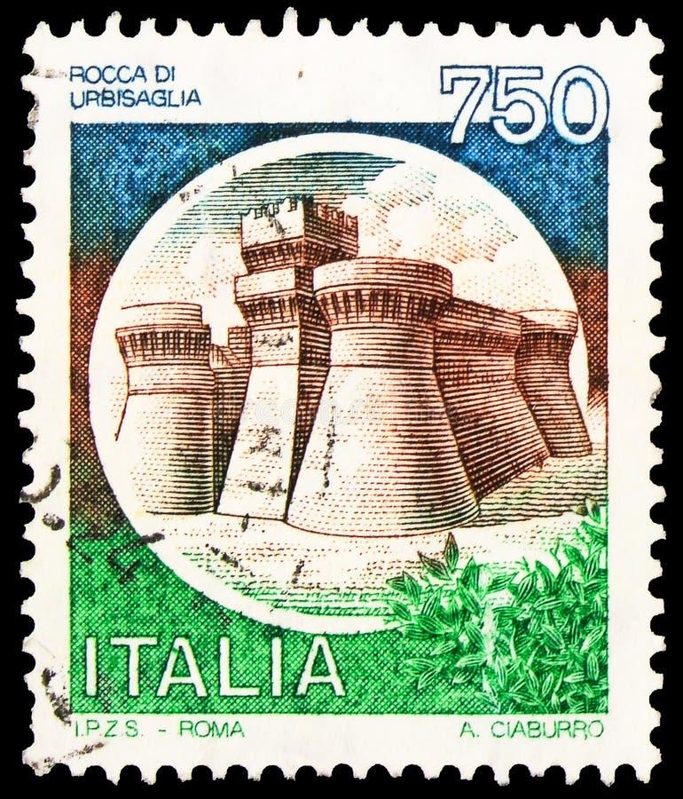 Postagstämpel i Italien visar Castle Urbisaglia, serie, circa 1990 royaltyfri fotografi