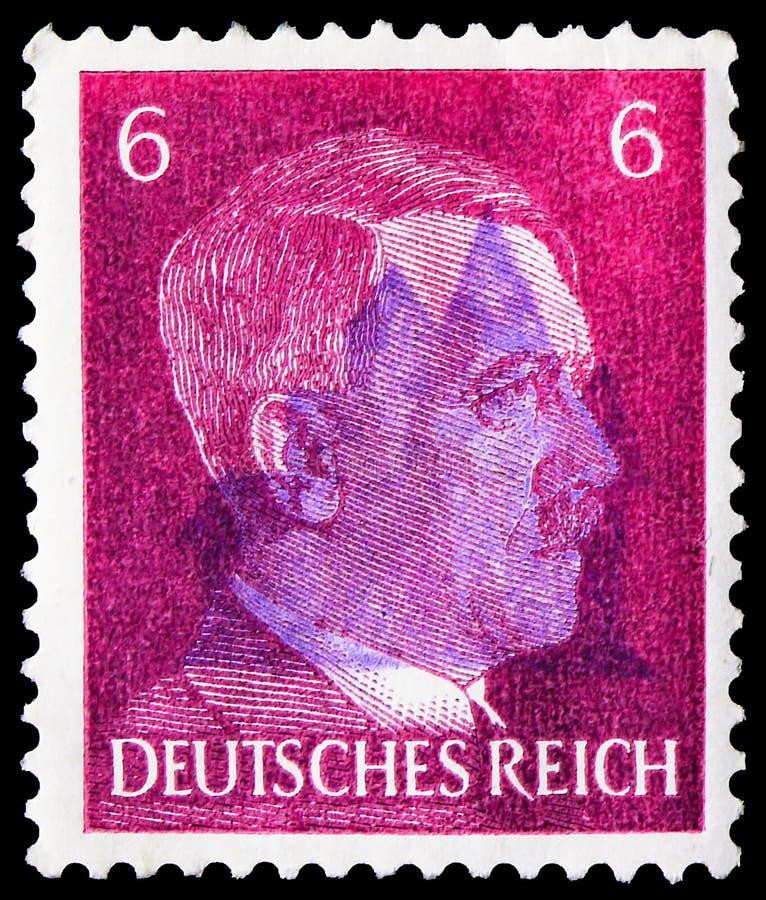 Postagstämpel på tyska Realm visar Adolf Hitler (1889-1945) kansler, Adolf Hitler-serien, circa 1941 fotografering för bildbyråer
