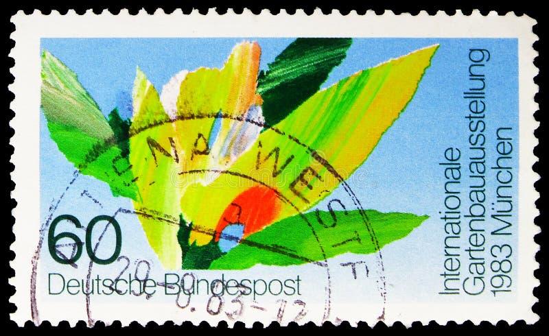 Postagstämpel som tryckts i Tyskland visar Stylized Flower, Fjärde International Horticultural Show, Munich, circa 1983 fotografering för bildbyråer
