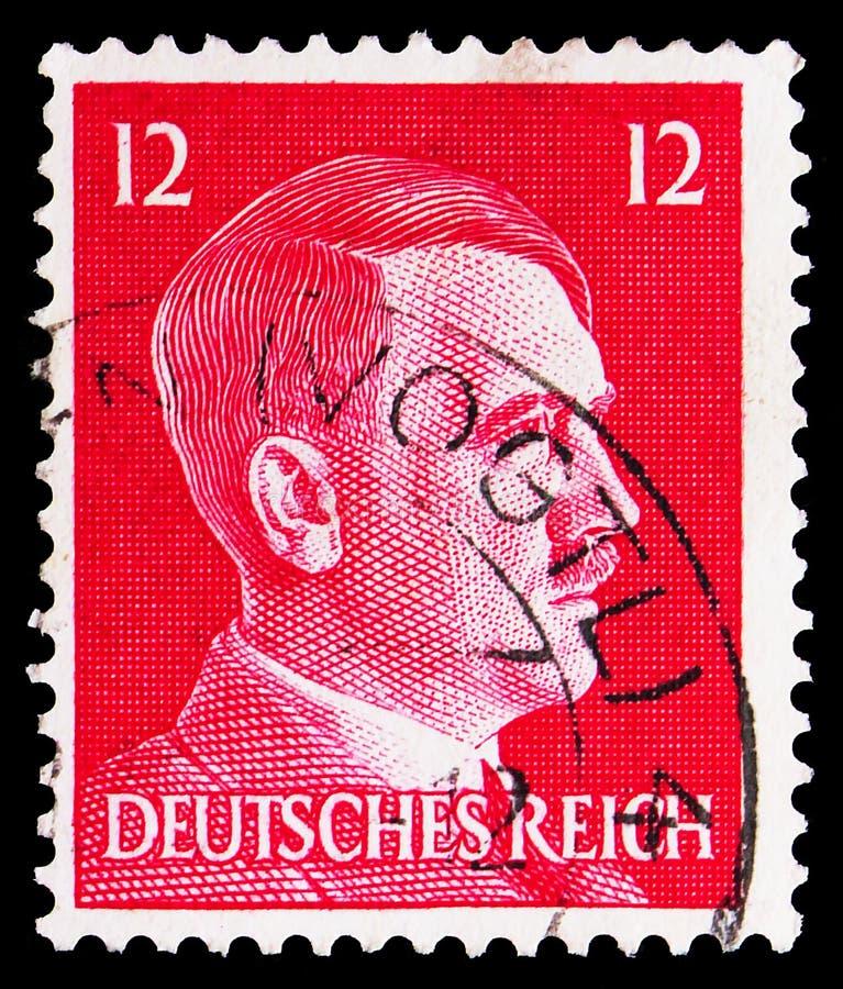 Postagstämpel tryckt på tyska Realm visar Adolf Hitler (1889-1945), kansler Adolf Hitler-serien, circa 1941 royaltyfri bild
