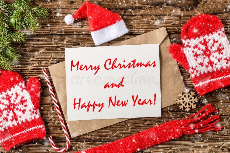 Postal de los saludos de la Feliz Navidad y de la Feliz Año Nuevo fotos de archivo libres de regalías