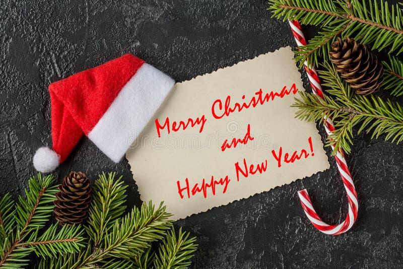 Postal de los saludos de la Feliz Navidad y de la Feliz Año Nuevo fotografía de archivo