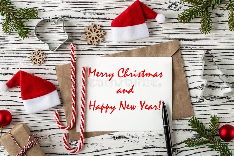 Postal de los saludos de la Feliz Navidad y de la Feliz Año Nuevo Visión superior fotografía de archivo