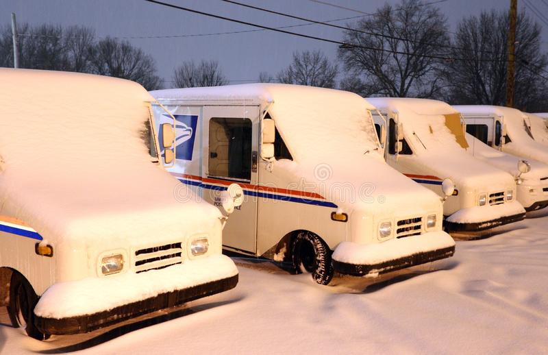 Postal Delivery Trucks Covered in Snow stock photos