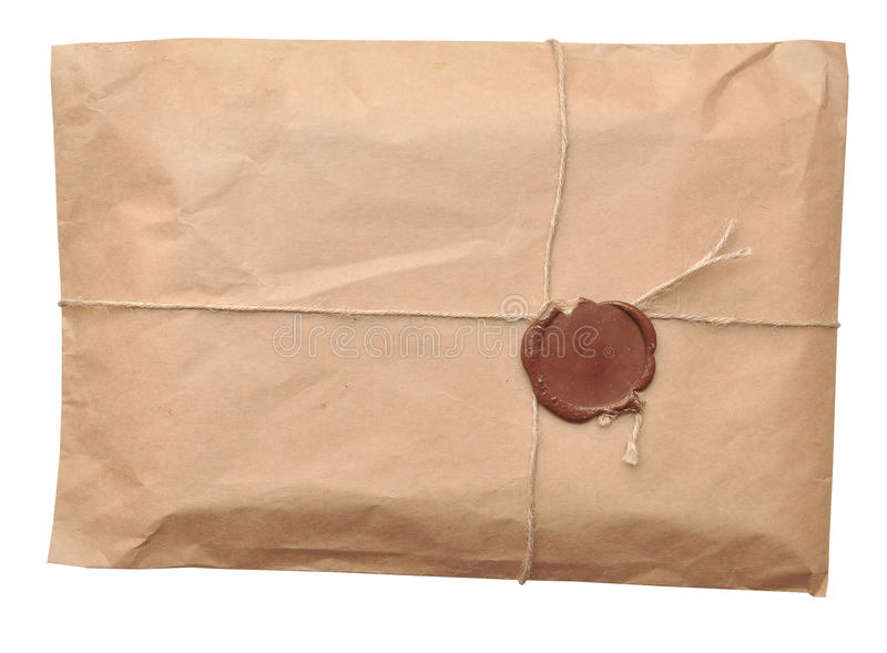 Postal parcel. Wrapped in coarse paper, isolated on a white background royalty free stock photography