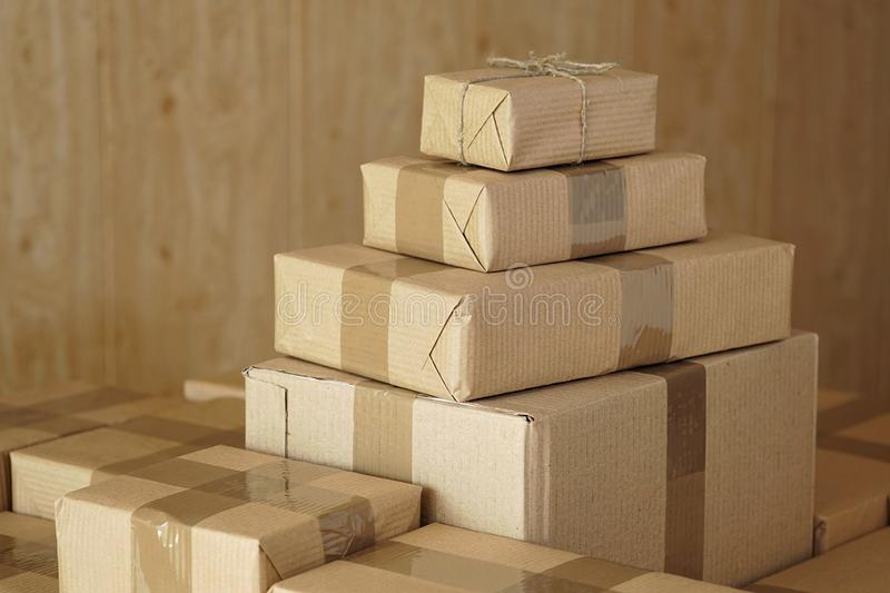 Postal parcels. Cardboard boxes of merchandise for shipment to international destinations royalty free stock photos