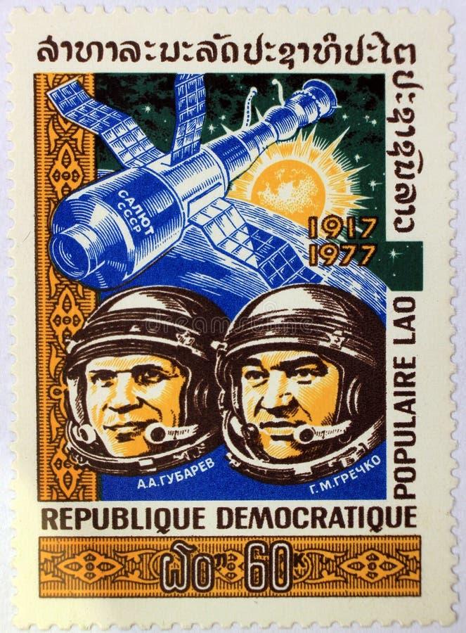 Postal stamp of Laos shows the Soviet cosmonauts Aleksei Gubarev and Georgi Grechko. Kharkiv, Ukraine - March 5, 2017: Postal stamp of Lao People`s Democratic royalty free stock photos