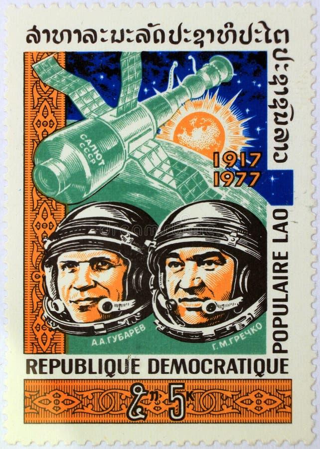 Postal stamp of Laos shows the Soviet cosmonauts Aleksei Gubarev and Georgi Grechko. Kharkiv, Ukraine - March 5, 2017: Postal stamp of Lao People`s Democratic royalty free stock photo