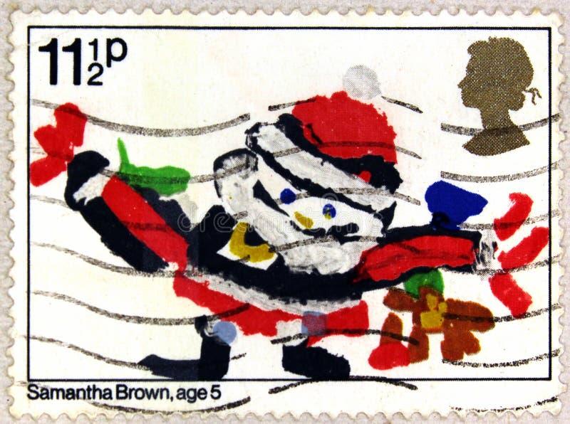 Postal stamp of United Kingdom shows Santa Claus, Drawing by Samantha Brown royalty free stock photos