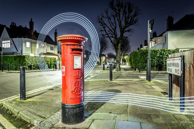 Postbox and light trails in London suburb stock images