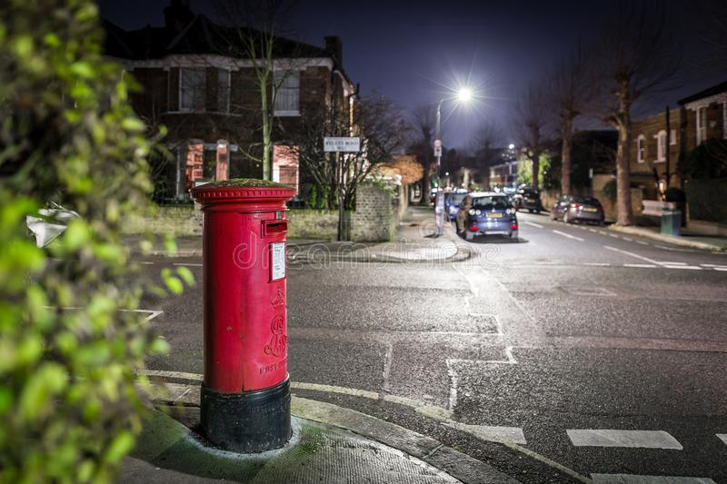Postbox and light trails in London suburb royalty free stock images