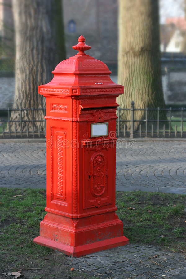 Postbox standing apart royalty free stock images