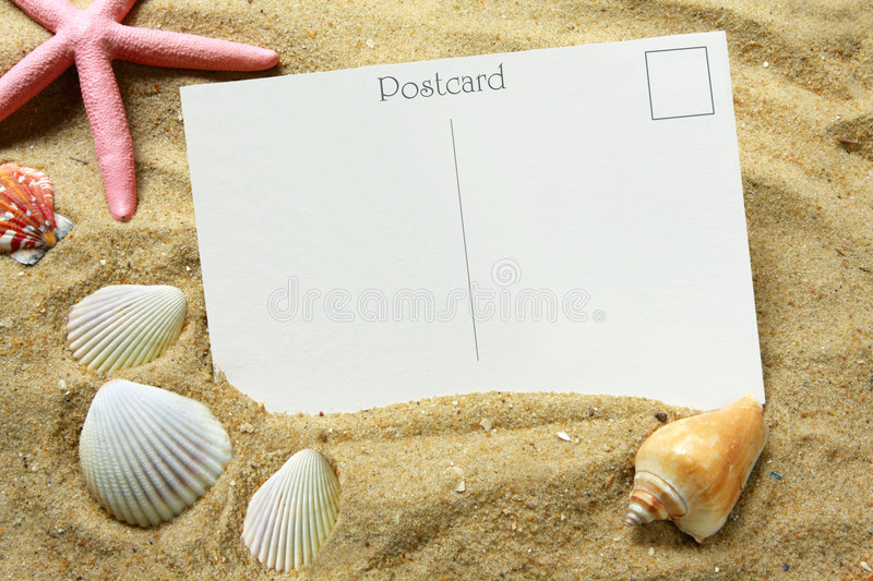 Postcard. Blank postcard in beach sand, with seashells and a starfish. Vacation time
