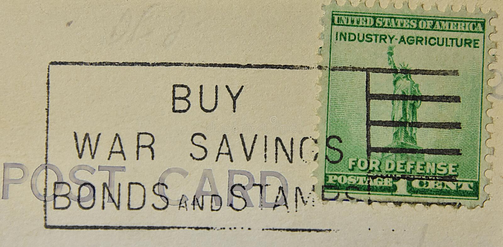 War Bond American Postmark Industry Agriculture for Defense. A postcard cancellation from World War II WWII urging Americans to buy war savings bonds and stamps royalty free stock images