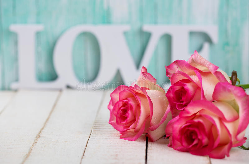 Postcard with elegant flowers and word love royalty free stock photography