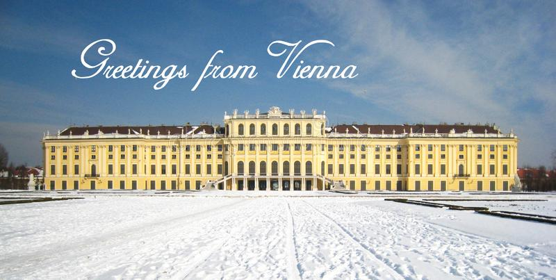 Postcard from a pretty winter atmosphere with the austrian palace in vienna covered with snow stock photos