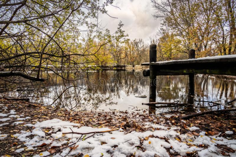 Snow on the Pier in the lake during Christmas. stock photos