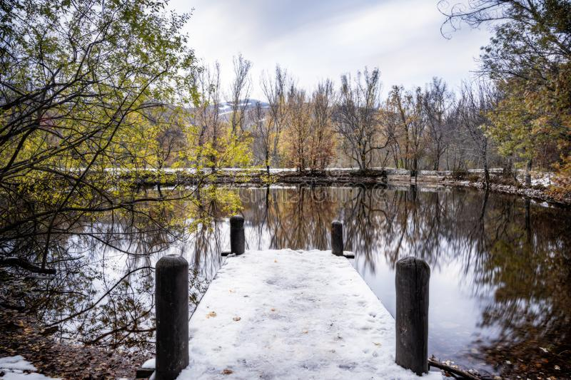 Snow on the Pier in the lake during Christmas. royalty free stock photos