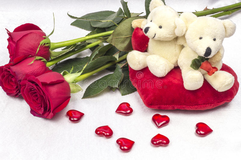 Postcard on Valentines day with roses and a soft toy. stock photography