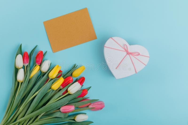 Spring tulips frame on background, top view. Postcard for Women`s Day. stock photos