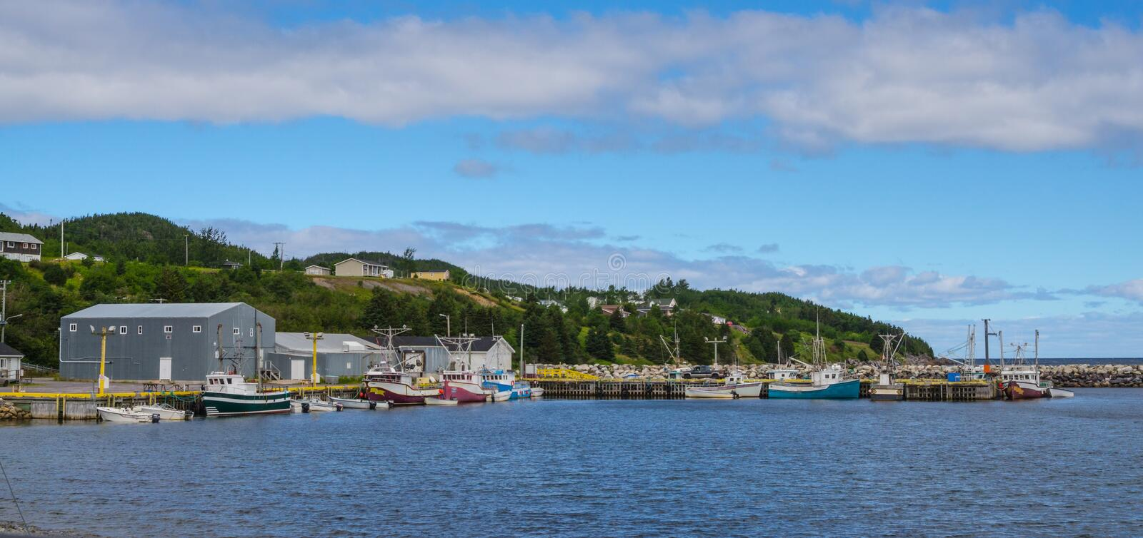 Postcards from Bonavista, Newfoundland fishing villages see boats at rest for the day on calm coastal water. Bonavista, Newfoundland fishing villages. Boats stock photo