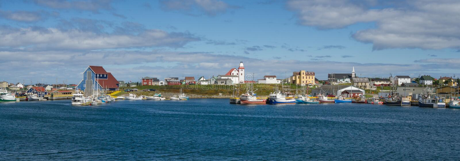 Postcards from Bonavista, Newfoundland fishing villages see boats at rest for the day on calm coastal water. Bonavista, Newfoundland fishing village. Boats tied royalty free stock photography