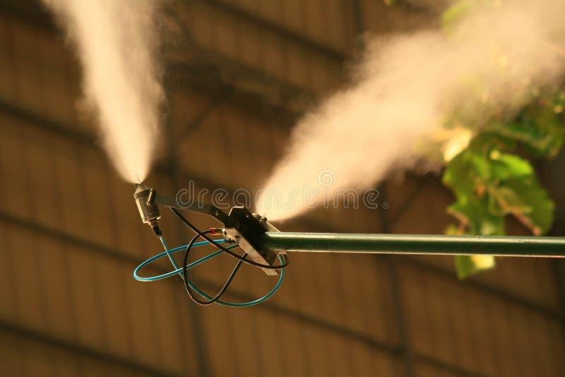 Poste del aerosol de la niebla en Atocha fotos de archivo