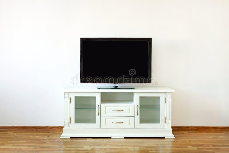 Poste TV sur le stand photo stock