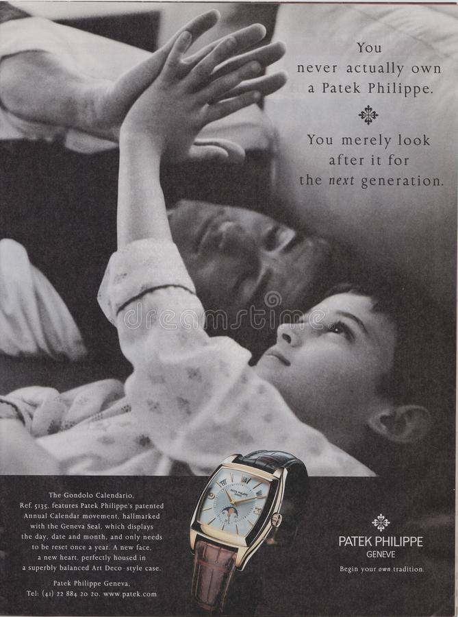 Poster advertising Patek Philippe Geneve watch in magazine from 2005, you never actually own a Patek Philippe slogan royalty free stock photography