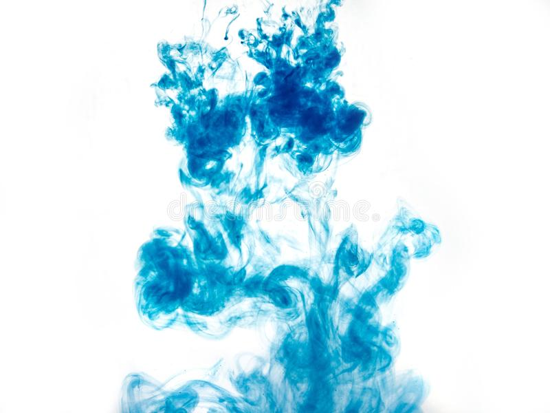 Poster color in water. Abstract background., Color paint drops in water. Ink swirling underwater, Cloud of silky ink collision on. White background. Colorful stock images